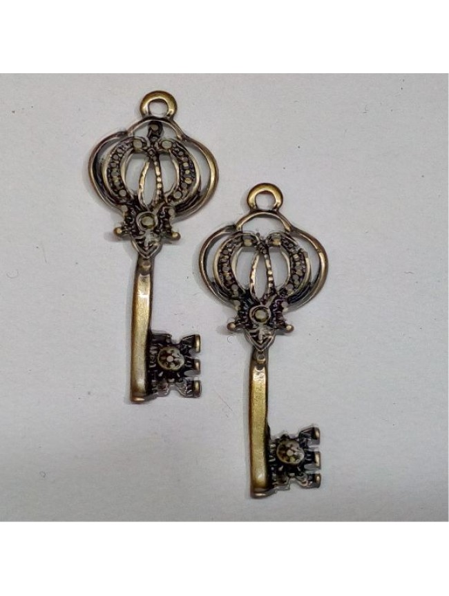 Metal charm-crown key